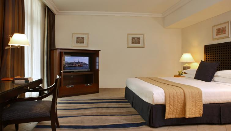 Large bed at Beach Rotana All Suites