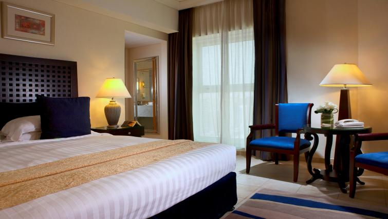 Spacious bedroom at Beach Rotana All Suites