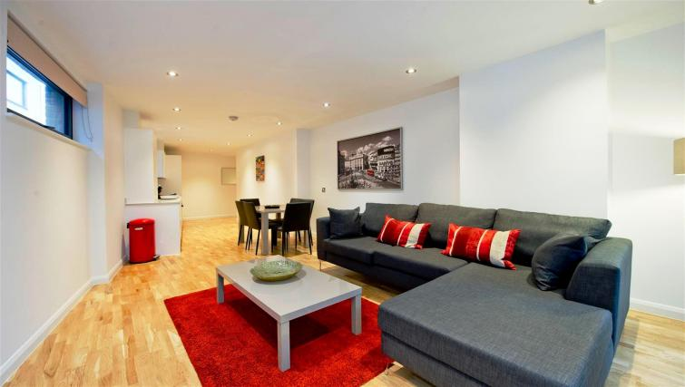 Red living room at Flying Butler London Bridge Apartments