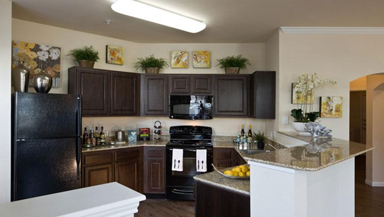 Equipped kitchen at Marquis at Cinco Ranch Apartments