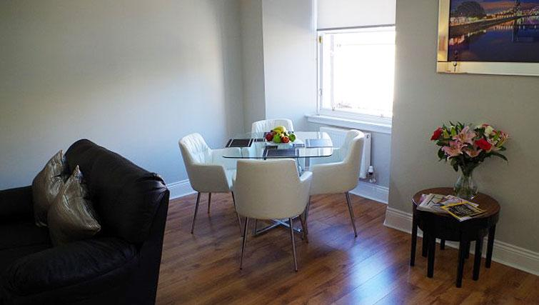 Dining table and chairs at Saint Vincent Street Apartments