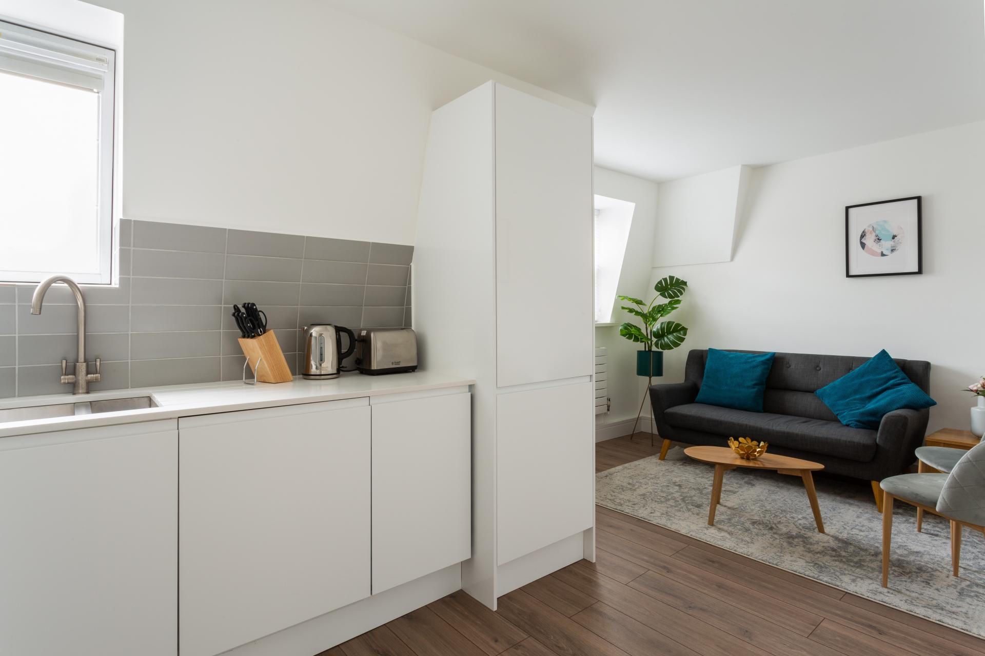 Open-plan living area at Flying Butler Vincent Square Apartments, Victoria, London