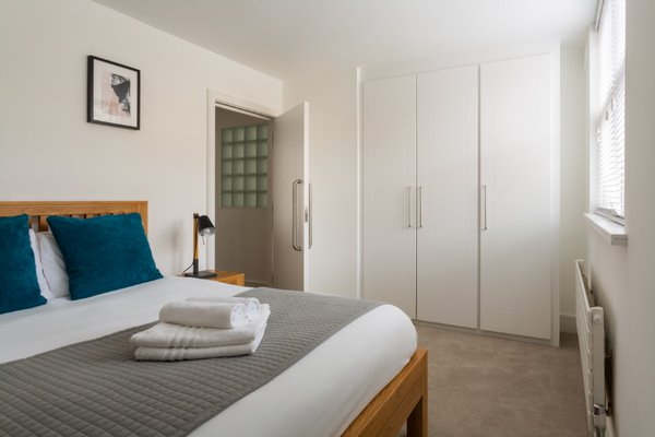 Bed at Flying Butler Vincent Square Apartments, Victoria, London