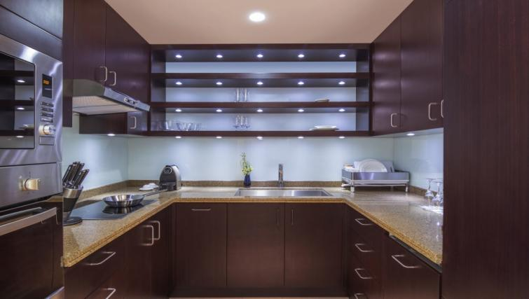 Equipped kitchen at City Centre Rotana Apartments