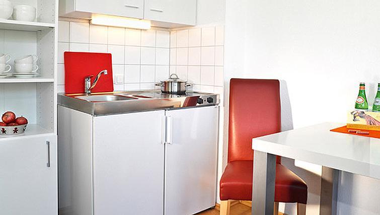 Functional kitchen in Frederics Smart Hohenzollernplatz Apartments