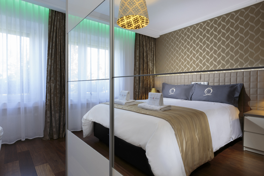 Modern bedroom at the Villa Vinicia Apartments