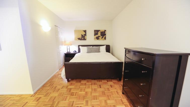 Queen size bed at Liberty Towers Studio
