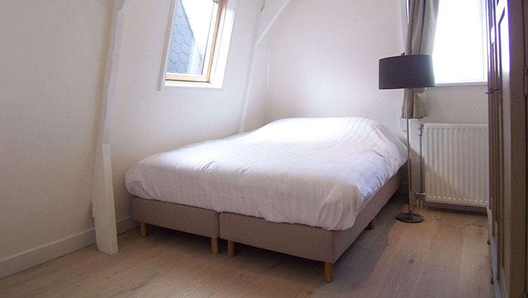 Double bed at Sugar III and Gym IV Apartments, Amsterdam