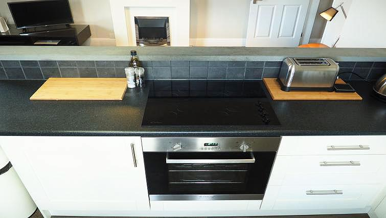 Equipped kitchen at Raby Street Apartment