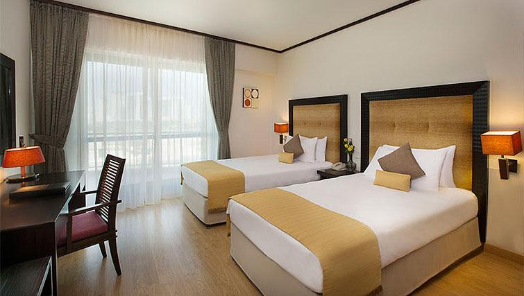 Twin bedroom at Park Hotel Apartments