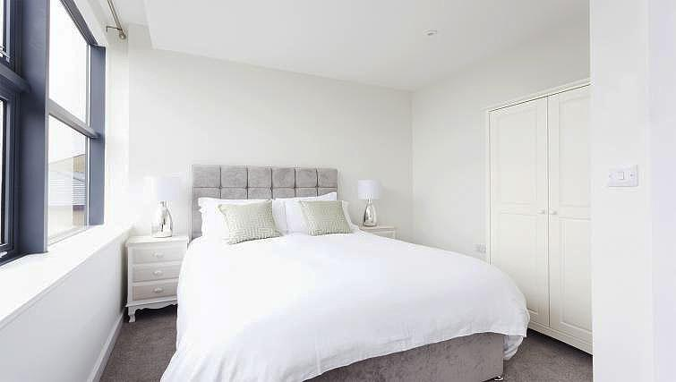 Bright bedroom at City Stay Apartments Centro