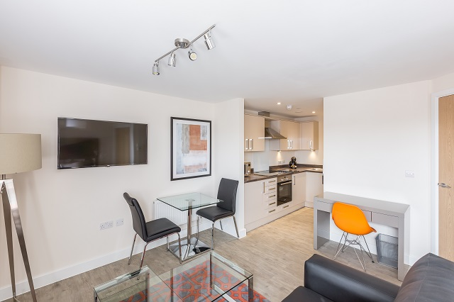 Open-plan living area at Central Gate Apartments