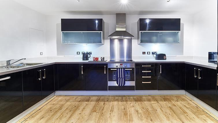 Fully equipped kitchen at Vizion Milton Keynes Apartments