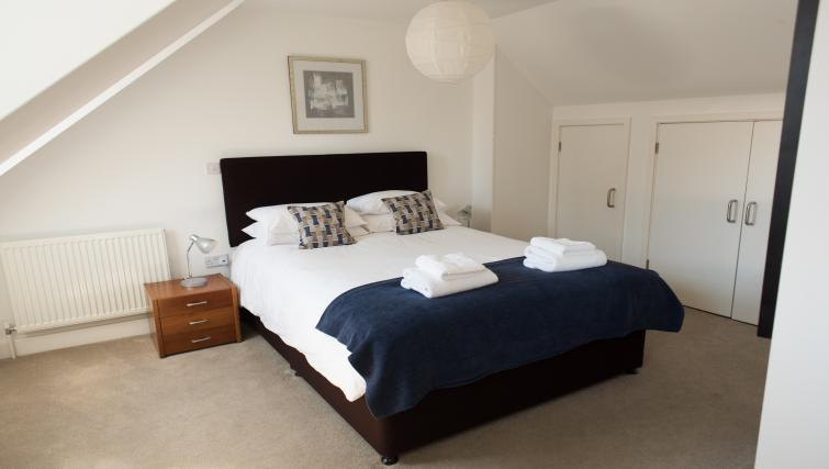 Comfortable bedroom at Nelson Court Apartments
