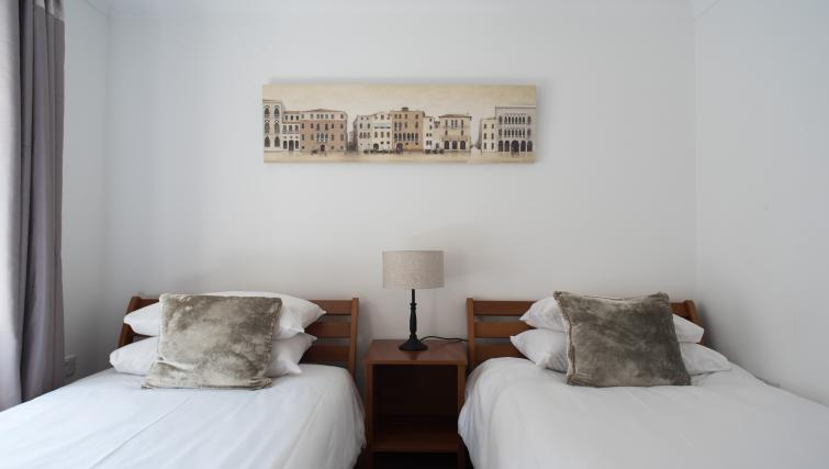 Twin beds at Nelson Court Apartments
