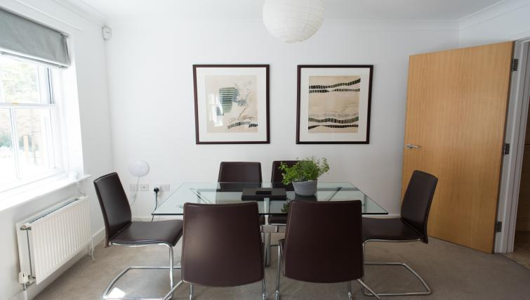 Dining table and chairs at Nelson Court Apartments