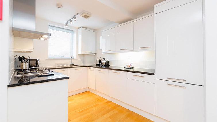 Kitchen area at Kew Bridge Court Furnished Apartments