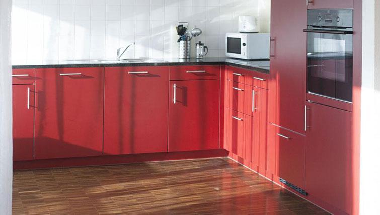 Red kitchen at Erlenmattstrasse 12 Apartments