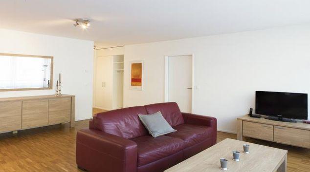 Living area at Erlenmattstrasse 12 Apartments