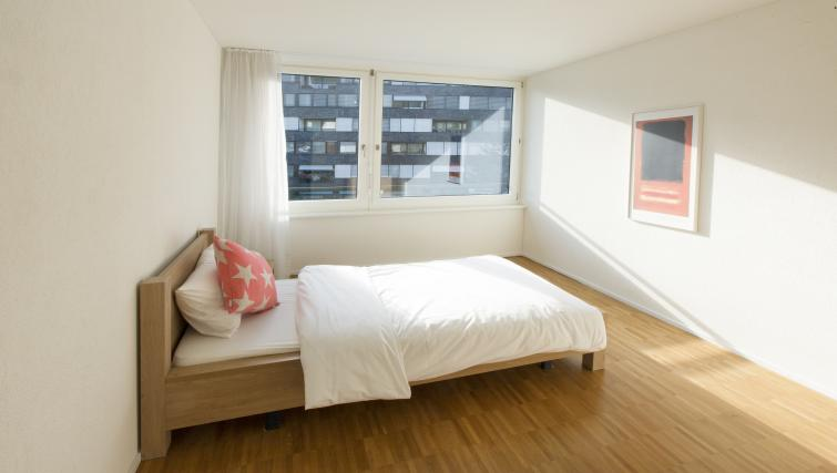 Bed at Erlenmattstrasse 12 Apartments