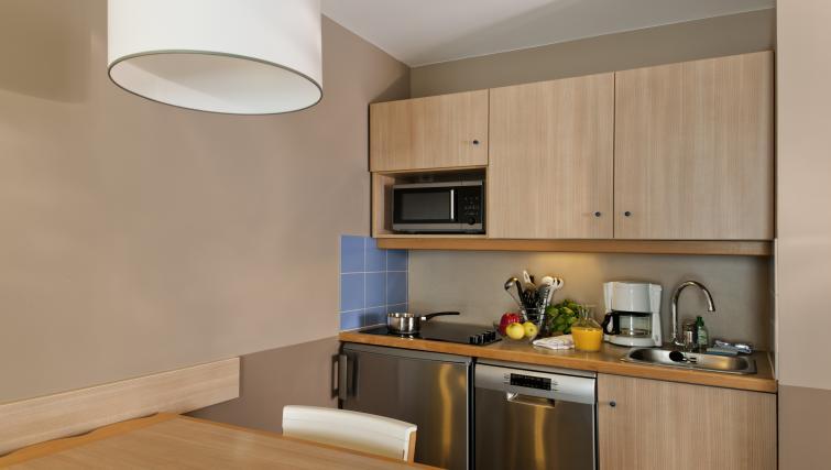 Basic kitchenette at Adagio Marne La Vallee Val d'Europe