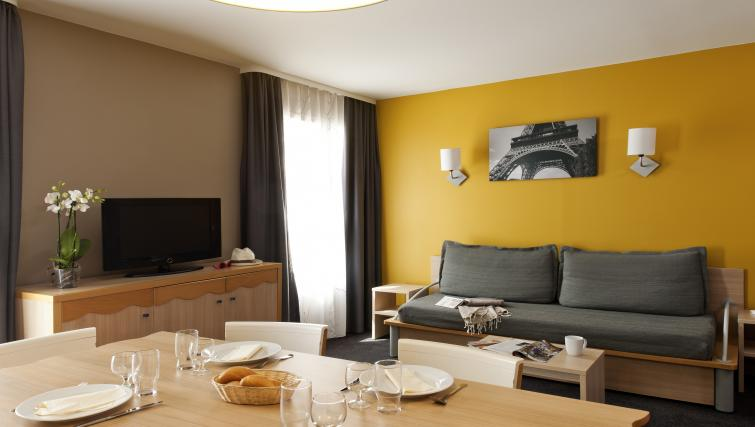 Stylish living and dining area at Adagio Marne La Vallee Val d'Europe