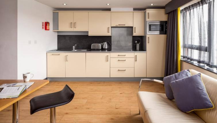 Kitchen at Roomzzz Leeds City West Apartments