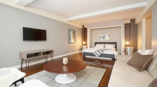 Open plan bedroom/living area at Central Park South Apartment