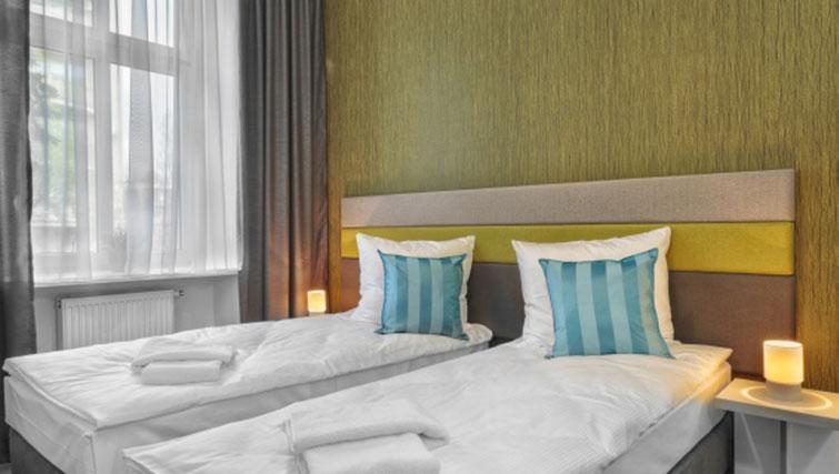 Twon bedroom at City Residence Łodź