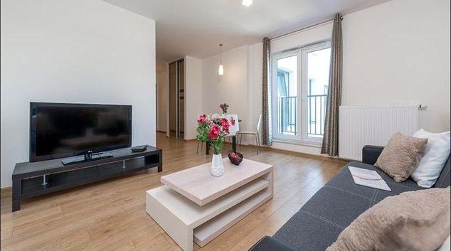 Living area at Obozowa Apartment