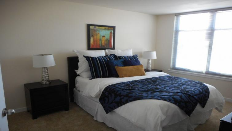 Comfortable bedroom at Wisconsin Place Apartments