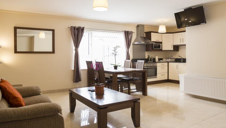 Spacious living area at Five Lamps Suites
