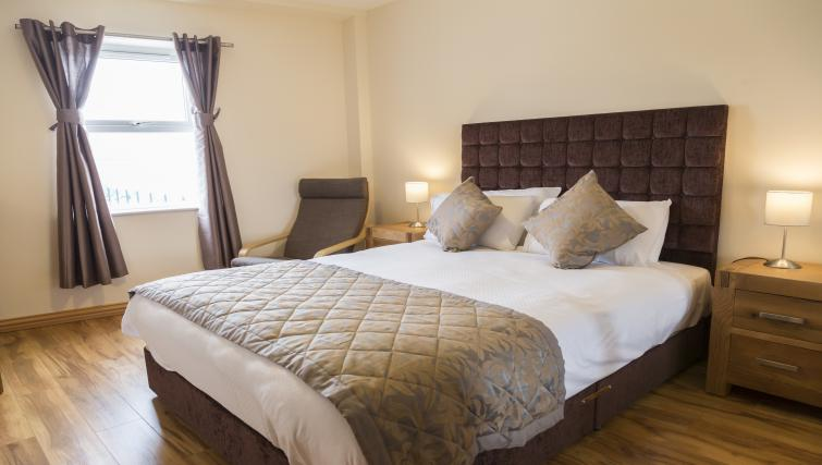King size bed at Five Lamps Suites