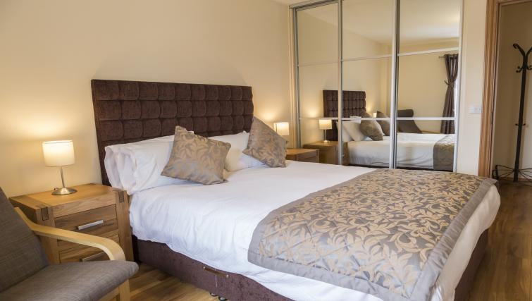 Large bed at Five Lamps Suites