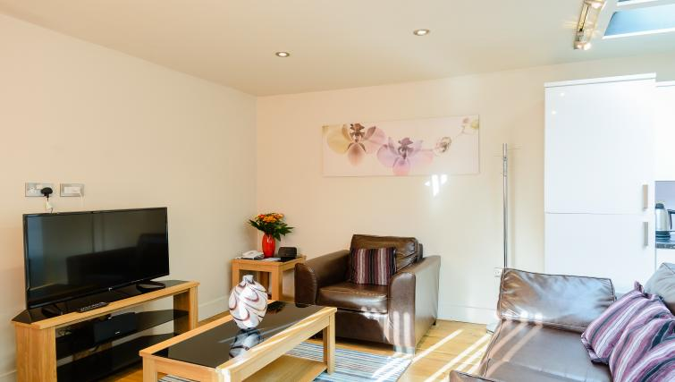 Stylish living area at Flying Butler Holborn Apartments