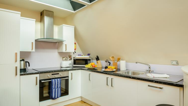 Equipped kitchen at Flying Butler Holborn Apartments