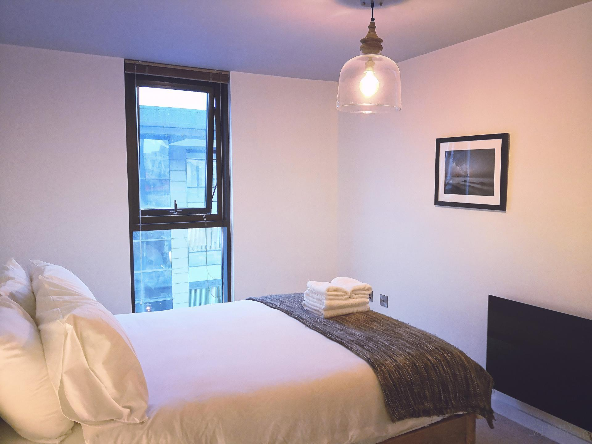 Double bed at Blonk Street Apartments