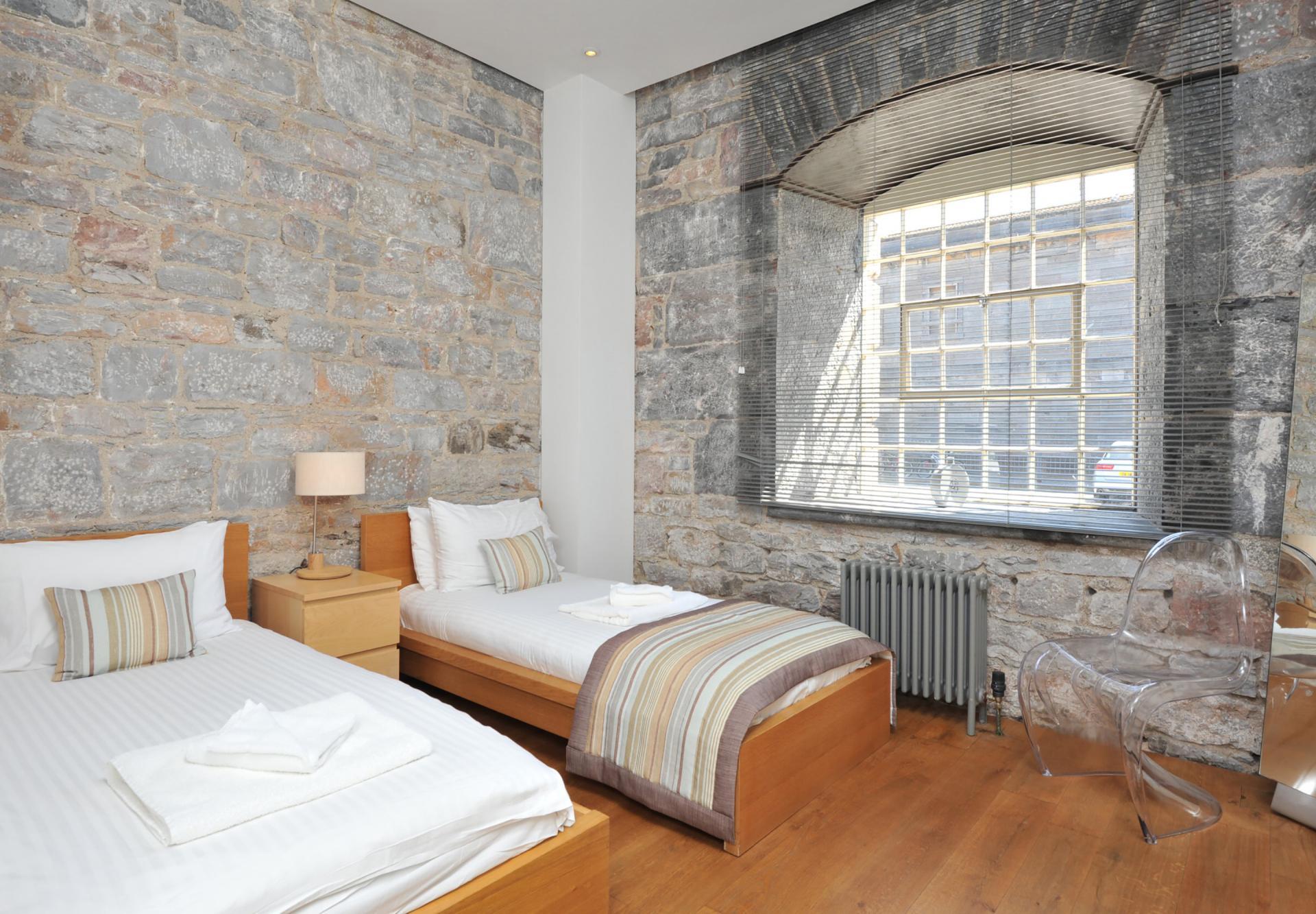 Twin beds at Drakes Wharf Apartments