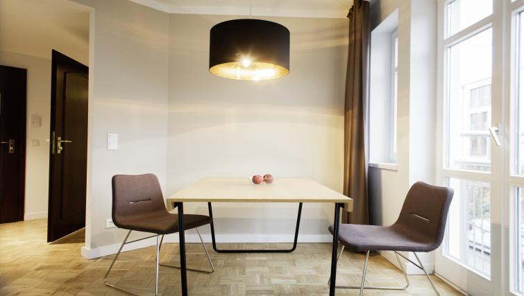 Dining table and chairs at Smartments Hamburg Außenalster Apartments