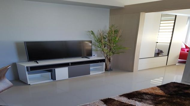 Living area with HD TV at Jazz Residences Tower D
