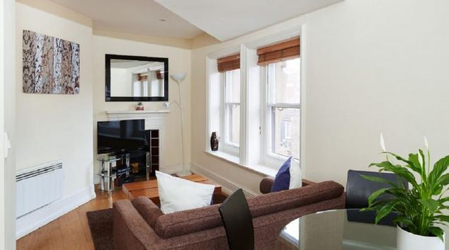 Bright living area at Charing Cross by Q Apartments