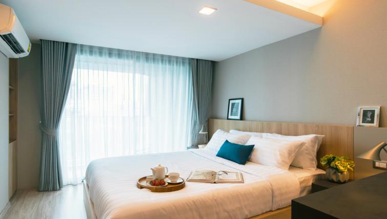 Bed at Somerset Ekamai Apartments