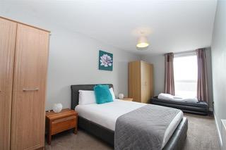 Spacious bedroom at Ingram Apartments, Merchant City, Glasgow
