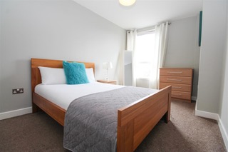 Light bedroom at Ingram Apartments, Merchant City, Glasgow