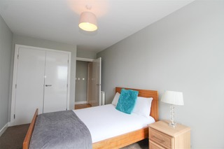 Large bedroom at Ingram Apartments, Merchant City, Glasgow