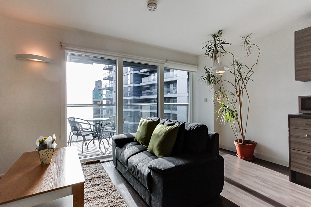 Bright living area at Dance Square Apartments