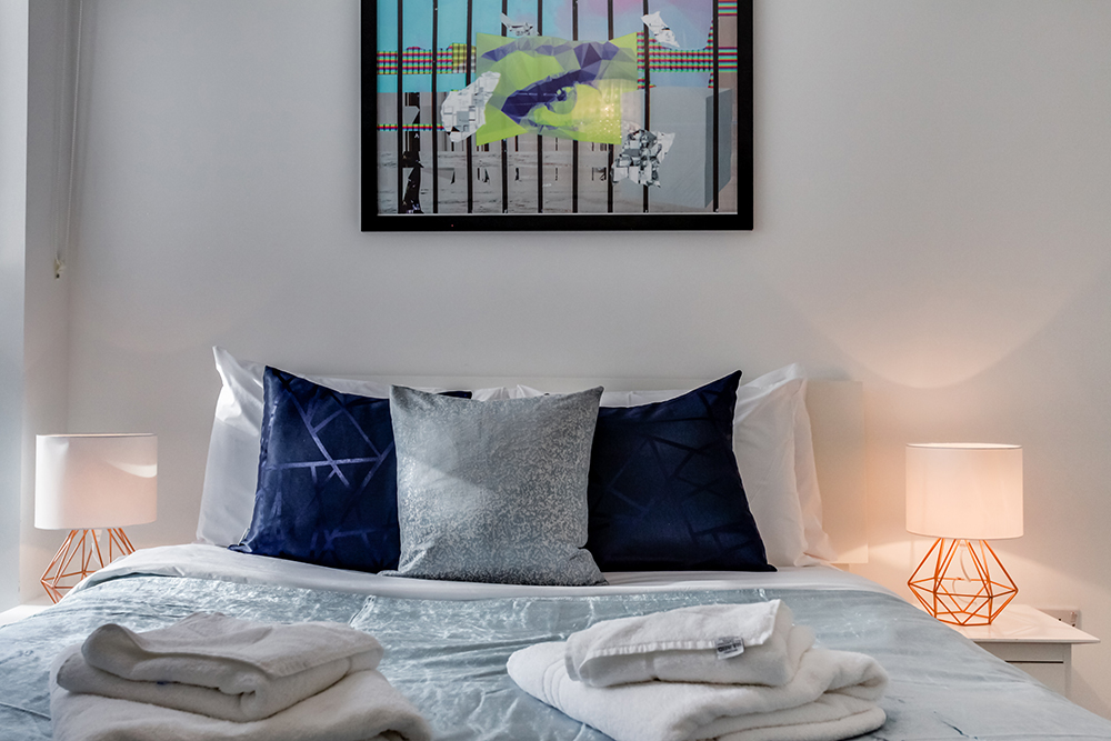Cosy bed at Dance Square Apartments