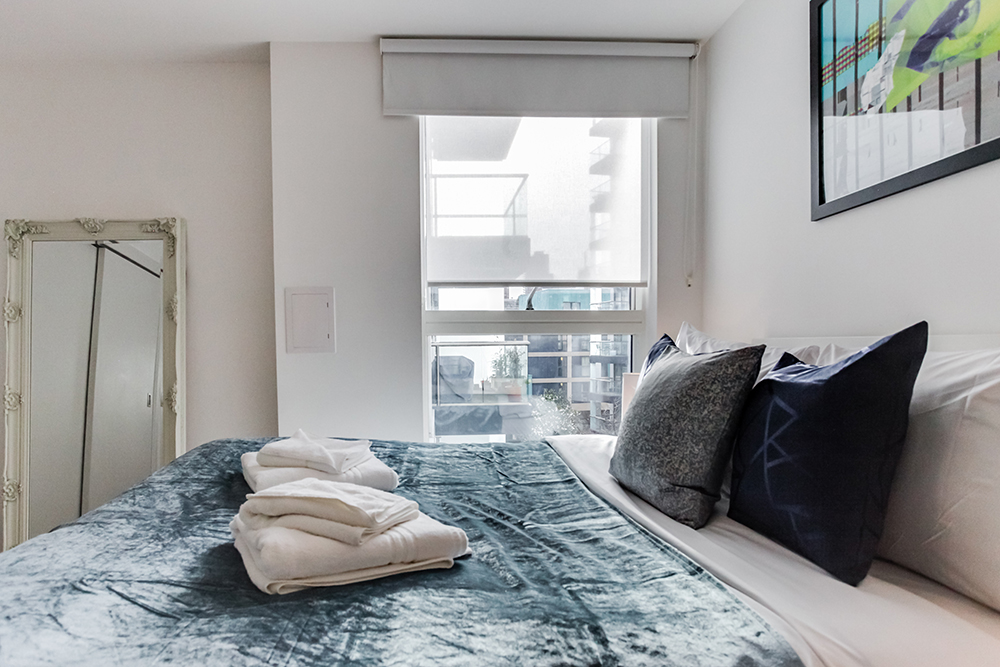 Comfortable bedroom at Dance Square Apartments