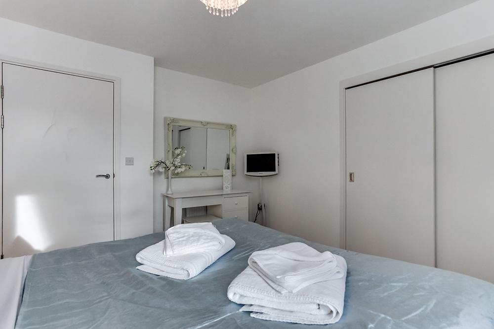 Spacious bedroom at Dance Square Apartments
