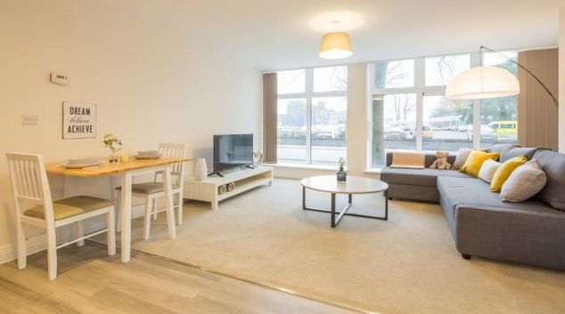 Spacious living area at Swingate House Apartments